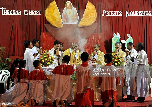 Indian Catholic Bishop of the Archdiocese of Hyderabad Reverend M Joji offers The Holy Eucharist during the evening mass of the Lord Supper...