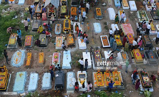 Indian Catholic Christians visit the graves of relatives at a Catholic cemetery during All Souls Day in Hyderabad on November 2 2013 All Souls Day is...