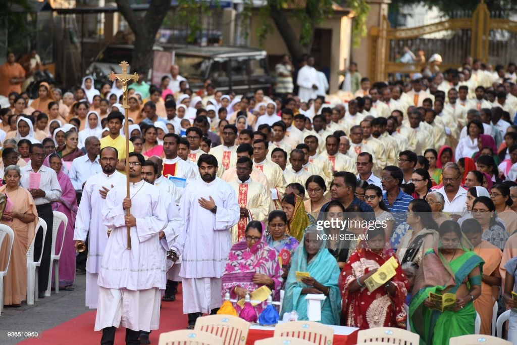 Indian Catholic Deacons and Priests proceed towards the