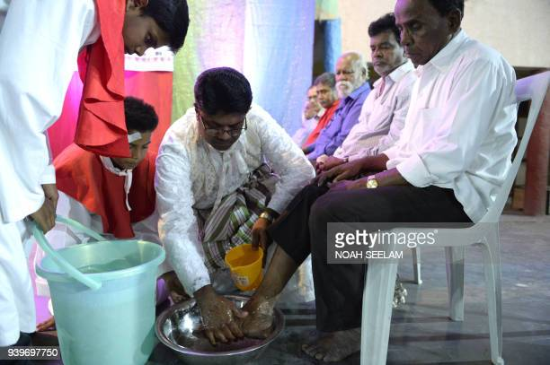 Indian Catholic Priest Father Dennis Bhasker washes the feet of a parishioner during a Maundy Thursday service at the St Alphonsus Church in...