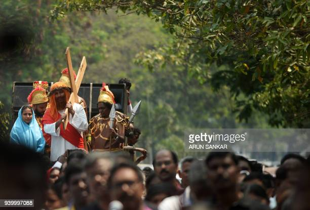 Indian Catholics take part in a procession to reenact the crucifixion of Jesus Christ on Good Friday in Chennai on March 30 2018 Passion plays are a...