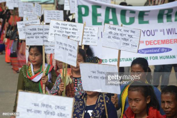 Indian Catholics volunteers of United Christian Forum for Human Rights of Tripura hold placards during a peace rally for preChristmas celebrations in...