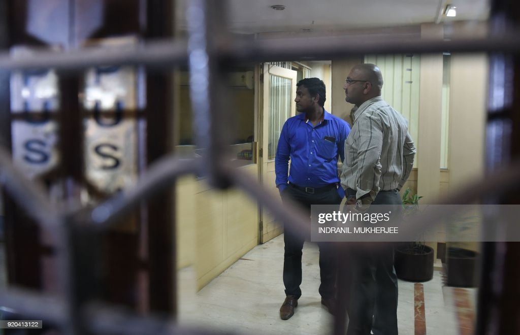 Indian Central Bureau of Investigation officials and bank staff are seen inside the Brady House branch of the Punjab National Bank which had been...