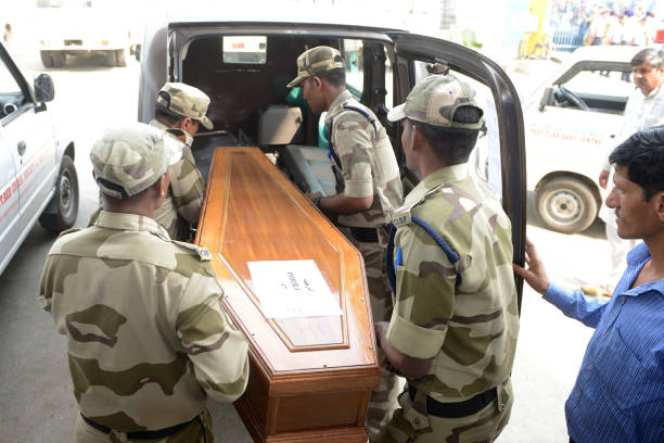 Indian Central Industrial Security Force personnel carry the coffin of Indian citizen Inderjeet who was killed in Iraq to an ambulance at the...
