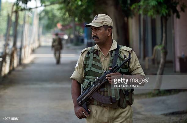 Indian Central Industrial Security Force personnel stand guard outside a storeroom containing Electronic Voting Machines at a counting centre in...