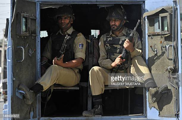 Indian Central Reserve Police Force on guard duty sit in a vechile in Srinagar on May 30 ,2012. A sneak attack by two motorcycle-borne suspected...