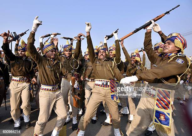 Indian Central Reserve Police Force personnel dance after the rehearsal for the forthcoming Republic Day parade at Rajpath on January 4 2017 in New...