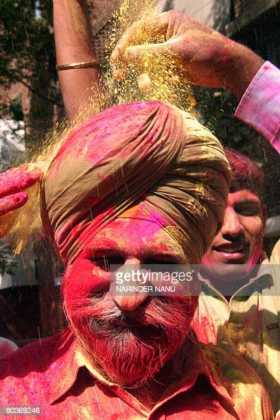 Indian Central Reserve Police Force soldiers celebrate 'Holi' the festival of colours at a CRPF camp in Amritsar on March 22 2008 The Holi festival...