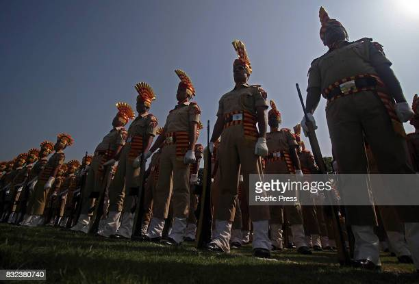 Indian Central Reserve Police Force soldiers parade during the official celebrations for India's Independence Day at Bakshi Stadium in Srinagar the...