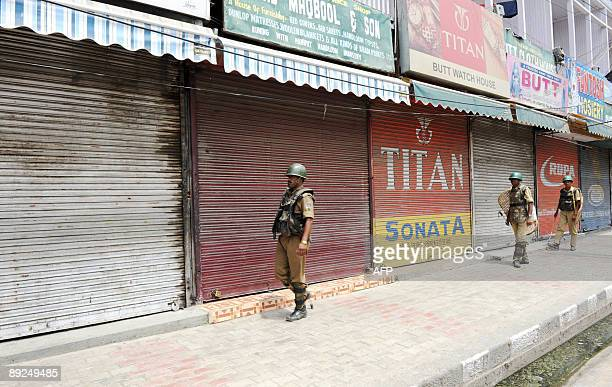 Indian Central Reserve Police Force soldiers patrol a deserted street during a strike in Srinagar on July 25 2009 The strike called by the hardline...