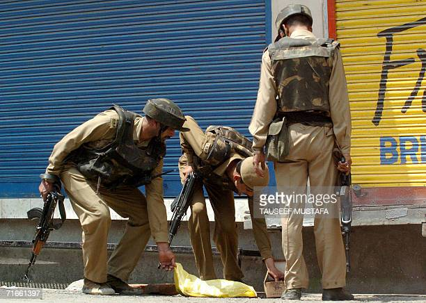 Indian Central Reserve Police Force soldiers search a bag during a cordon and search operation at Kukar Bazar in Srinagar, 17 August 2006, following...