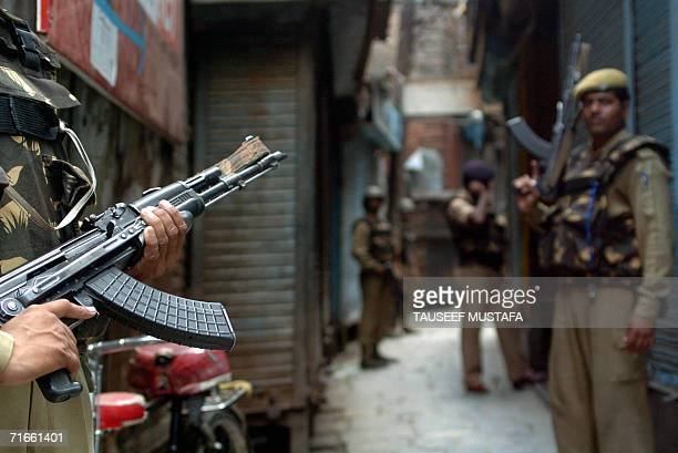Indian Central Reserve Police Force soldiers stand alert during a cordon and search operation at Kukar Bazar in Srinagar, 17 August 2006, following...