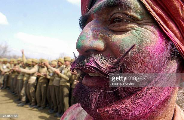 Indian Central Reserve Police Force soldiers with colours spread celebrate Holi at a CRPF camp in Srinagar 04 March 2007 Holi the festival of colours...