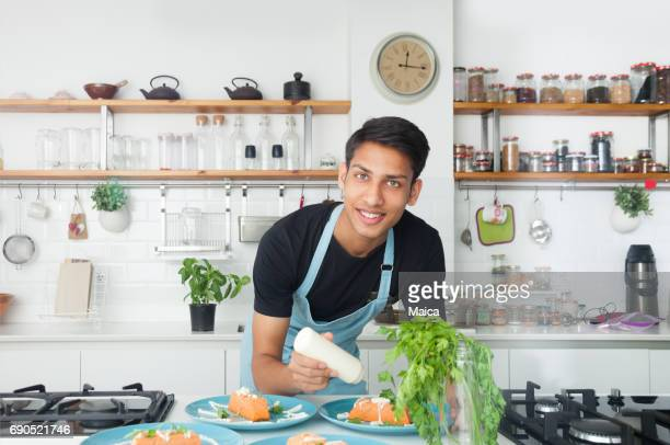 Indian chef cooking in a modern kitchen