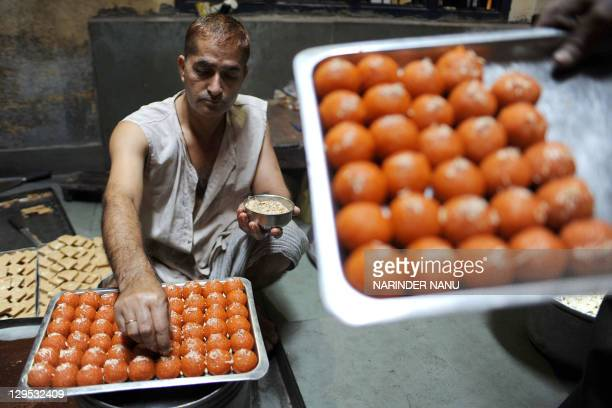 Indian chef Parmanand prepare sweets at a kitchen in Amritsar on October 18 2011 The sweets are in heavy demand during the upcoming Hindu festival...