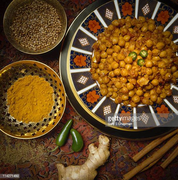 Indian chickpea curry dish and raw spices