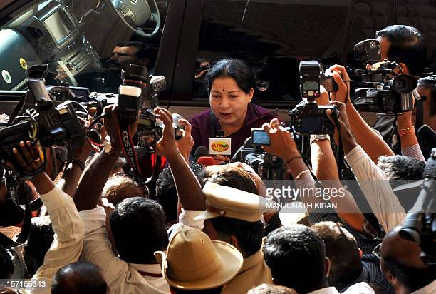 Indian chief minister of Tamil Nadu J Jayalalithaa arrives at a hotel in Bangalore to take part in talks with chief Ministers of Tamil Nadu and...
