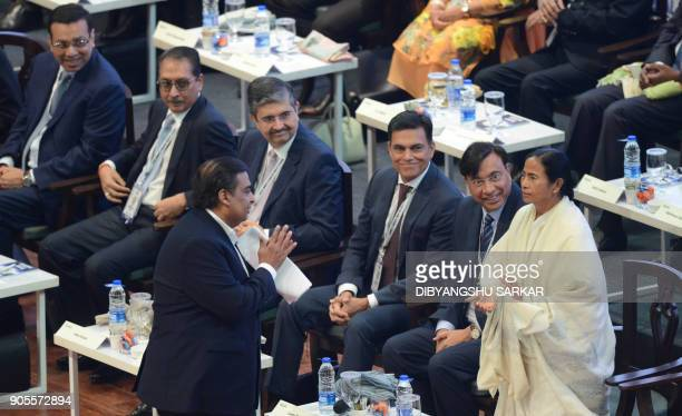 Indian chief minister of the eastern Indian state of West Bengal Mamata Banerjee greets businessman Mukesh Ambani at the start of the Bengal Global...