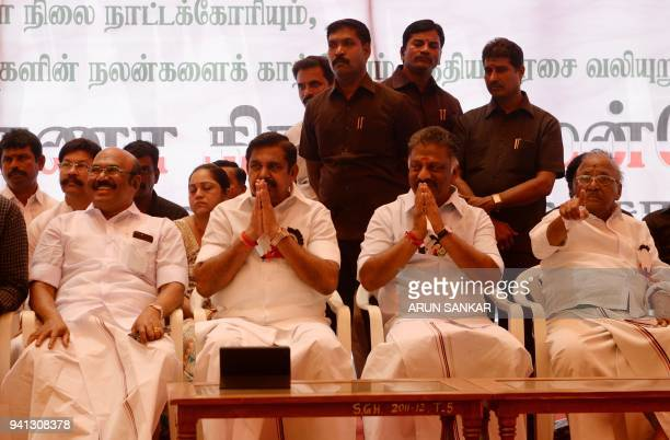 Indian Chief Minister of the state of Tamil Nadu Edappadi Palanisamy and Deputy Chief Minister O Pannerselvam gesture to members of the All India...