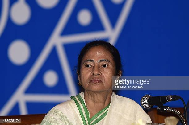 Indian Chief Minister of West Bengal, Mamata Banerjee looks on during a meeting with Bangladeshi cultural personel in Dhaka on February 20, 2015....