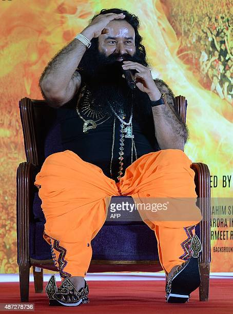 Indian chief of the religious sect Dera Sacha Sauda Gurmeet Ram Rahim Singh gestures during a news conference to launch the score for his forthcoming...