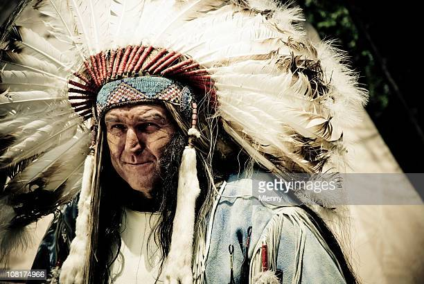 indian chief wearing headdress - headdress stock pictures, royalty-free photos & images