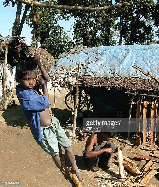 Indian child Kanu Baske of the Adibashi Santhal tribe plays near his temporary shelter at a refugee camp located in the Bodo Territorial Council And...