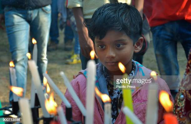 Indian child light candles during Christmas prayers at St Paul's Cathedral church