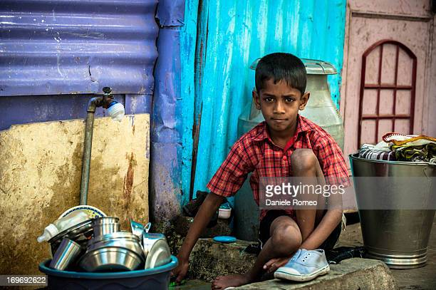 Indian child while washing dishes, Pune, Maharashtra, Faces, Child, Children, Indian, portrait, Indian culture, Travel, Travel destination, street...