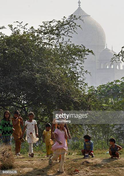 Indian children defecate in the open air near the Taj Mahal in Agra India on Tuesday Nov 25 2008 In the shadows of the Taj Mahal is Agra an ancient...