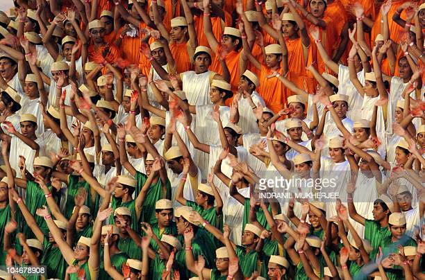 Indian children dress in the national flag's colours perform in the XIX Commonwealth Games opening ceremony at the Jawaharlal Nehru stadium in New...