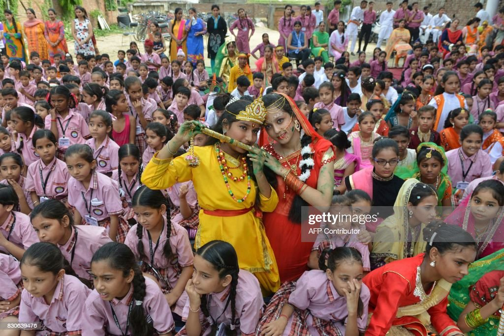 Indian children dressed as Hindu deities Krishna and Radha pose during an event at a school in Amritsar on August 12 ahead of Indian Independence Day.