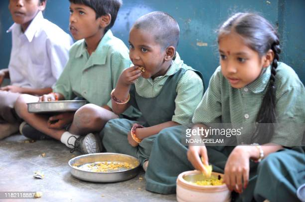 Indian children eat their midday meal at a Government High School in Hyderabad on January 10 2012 Levels of undernutrition in the country were...