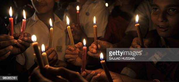Indian children hold candles during an Earth Hour campaign in Mumbai on March 27 2010 Dozens of Indians lit candles to observe Earth Hour and called...
