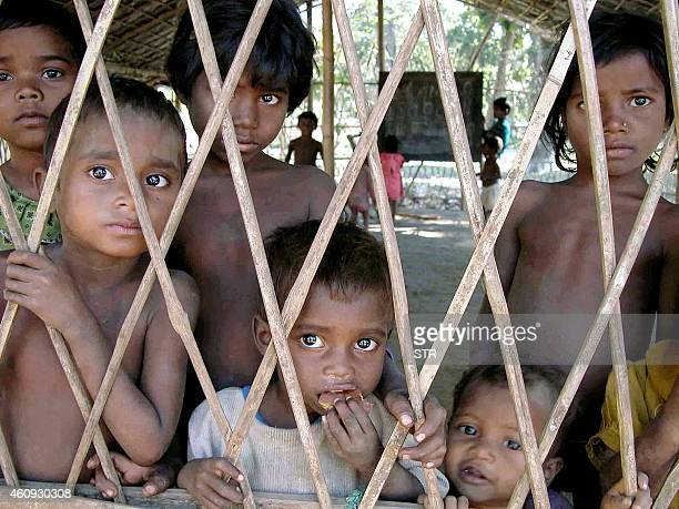 Indian children of the Adibashi Santhal tribe are pictured at a refugee camp located in the Bodo Territorial Council And Districts area some 270 kms...
