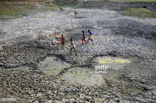 Indian children play on parched area of shrunken Varuna River in Phoolpur village some 45 kms from Allahabad on May 142016Much of India has been...