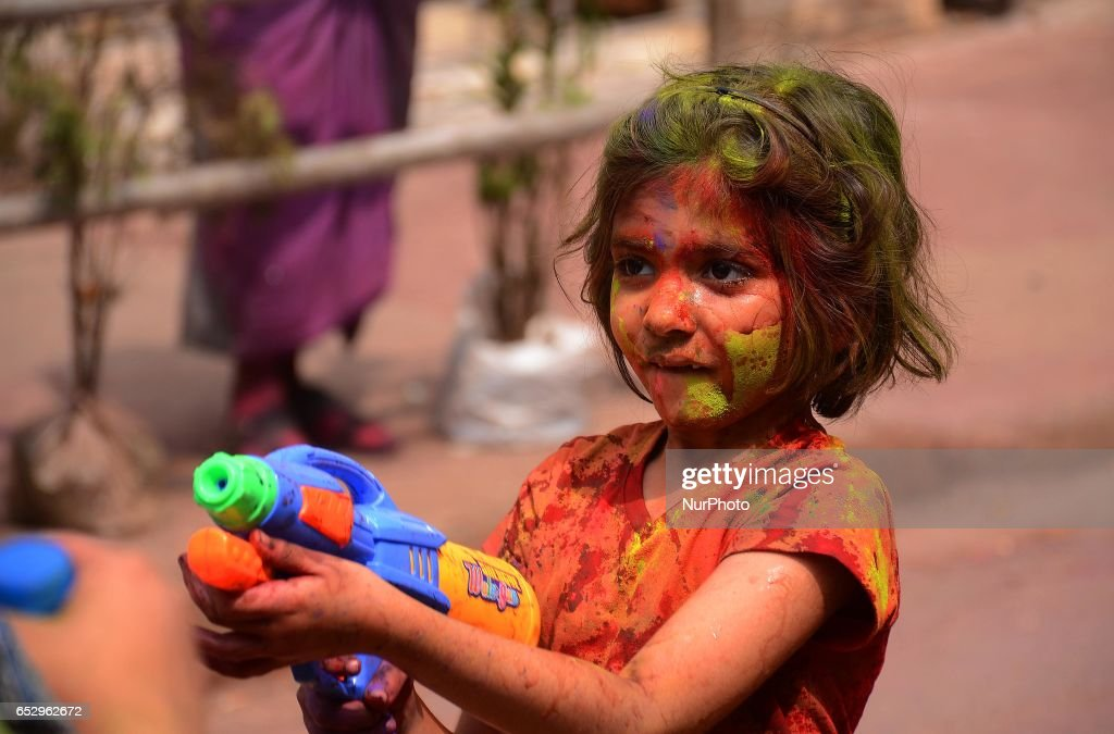 Indian children playing with colour water during Holi festival in Kolkata, India on Monday, 13th March, 2017. Holi , festival of colours celebrated all over in India.