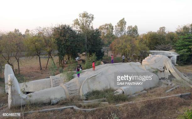 TOPSHOT Indian children run over an incomplete model of a large male figure based on the character Lemuel Gulliver from the classic novel Gulliver's...