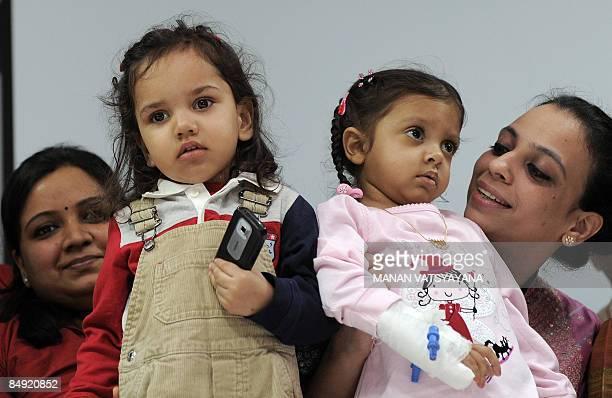 Indian children twentytwo month old Shourya Verma and twoyear old Siya Thakur pose at the Sir Ganga Ram hospital in New Delhi on February 19 as their...