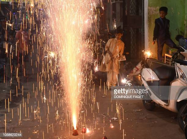 Indian children watch firecrackers during Diwali Festival celebrations in New Delhi on November 7 2018 Diwali the Festival of Lights marks victory...