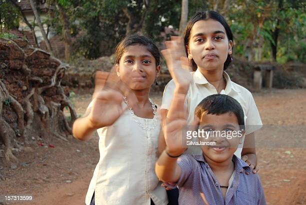 indian children waving with their hands