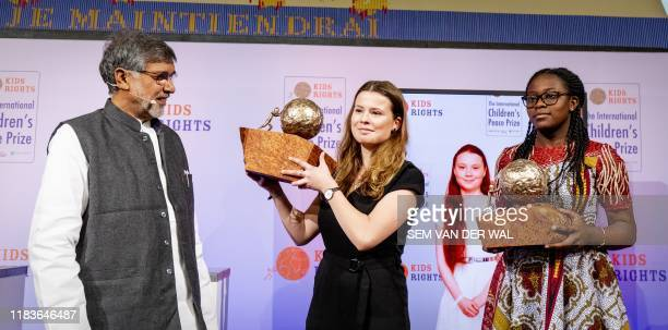 Indian children's right's activist and 2014 Nobel Peace Prize Laureate Kailash Satyarthi presents the International Children's Peace Prize 2019 to...