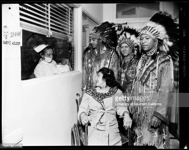 Indian Christening 9 April 1954 Nurse Virginia KunklePrincess White Cloud Mrs Judith McGuireWilliam McGuireCaption slip reads 'Photographer Mitchell...
