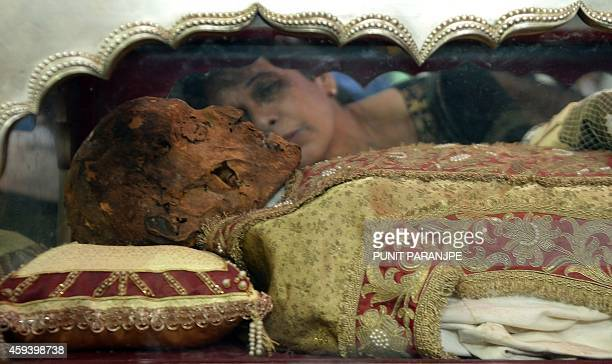 Indian Christian kisses a casket carrying the remains of the St Francis Xavier at the Se Cathedral in Goa on November 22 2014 The 17th exposition of...