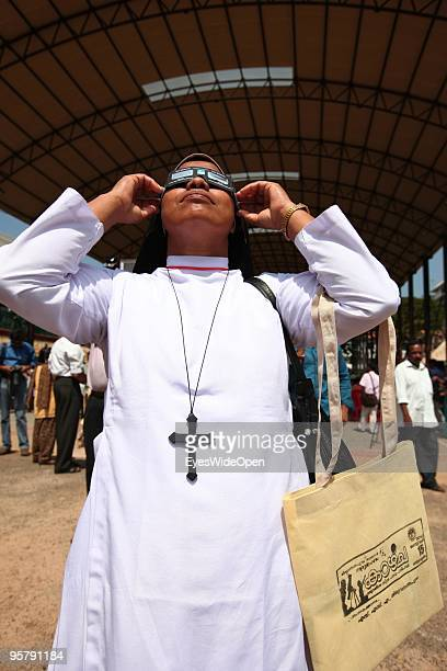 Indian christian nun observes the rare Annular Solar Eclipse at the central stadium on January 15 2010 in Thiruvananthapuram Kerala South IndiaThis...