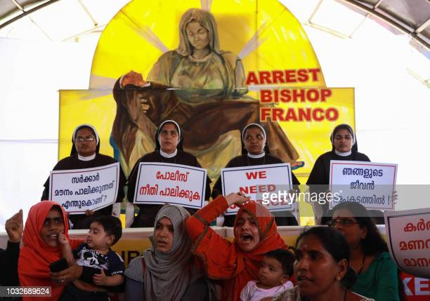 Indian Christian nuns and Muslim supporters protest as they demand the arrest of Bishop Franco Mulakkal who is accused of raping a nun outside the...