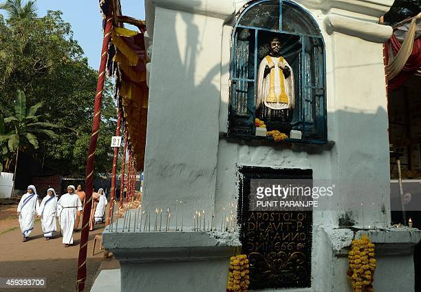 Indian Christian nuns arrive at the Basilica of Bom Jesus before the start of a procession carrying the remains of St Francis Xavier in Goa on...