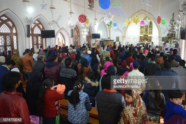 Indian Christian offer prayers during a service to mark Christmas Day at a church in Amritsar on December 25 2018 Despite Christians forming a little...
