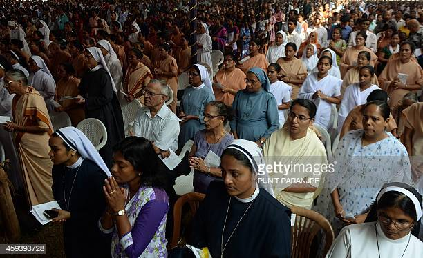 Indian Christians attend prayers at the Basilica of Bom Jesus before the start of a procession carrying the remains of St Francis Xavier in Goa on...