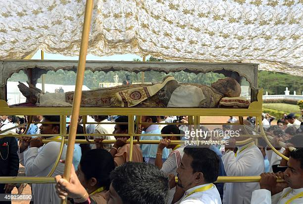 Indian Christians carry the remains of St. Francis Xavier towards the Se Cathedral during a procession in Goa on November 22, 2014. The 17th...